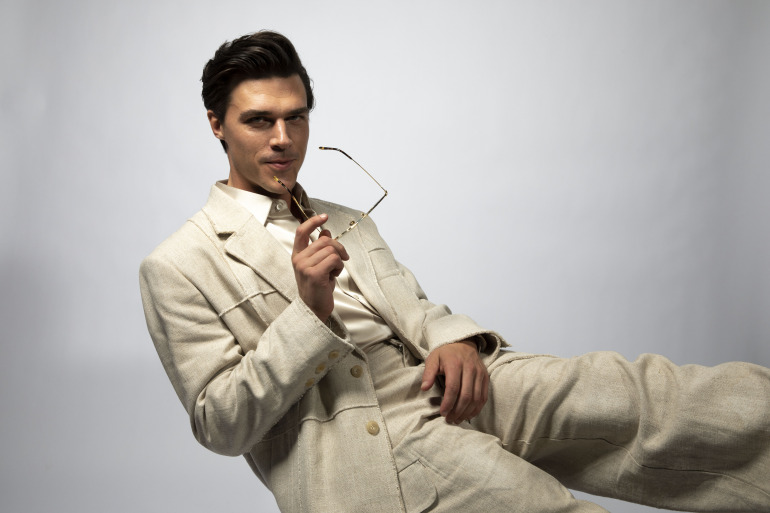 GQ Finn Whittrock Photoshoot White Suit Eye Glasses Leaning Back