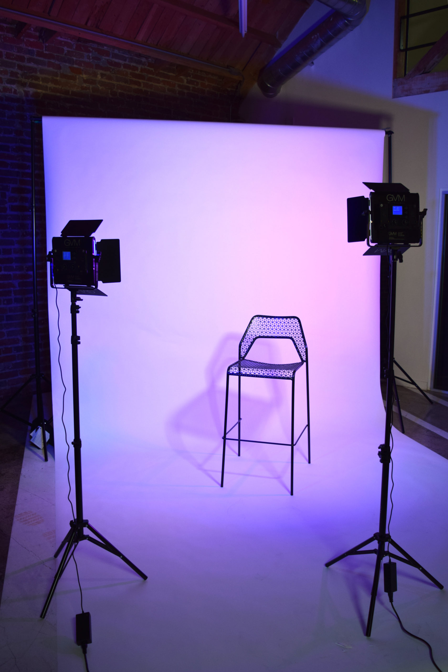MGS Photoshoots White Seamless Backdrop Setup with Lights and Chair
